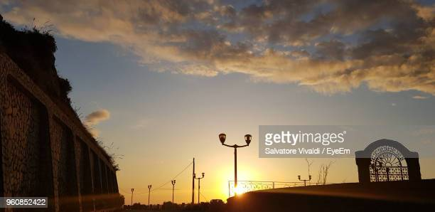 low angle view of street lights against sky during sunset - vivaldi salvatore foto e immagini stock