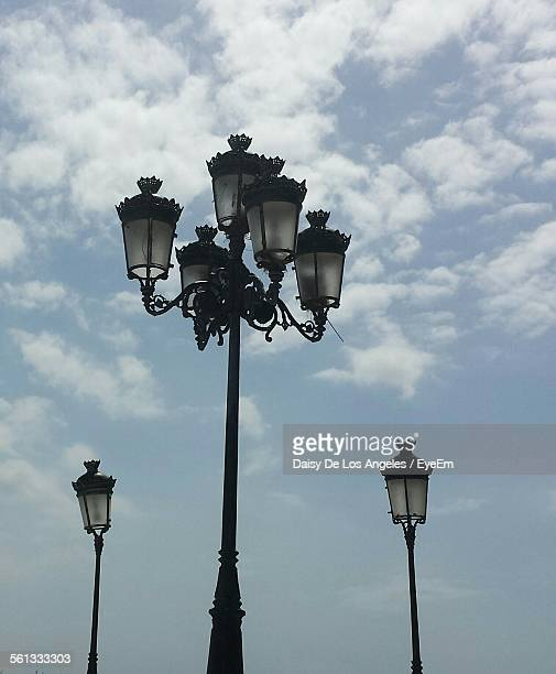 low angle view of street lights against sky - ガス燈 ストックフォトと画像