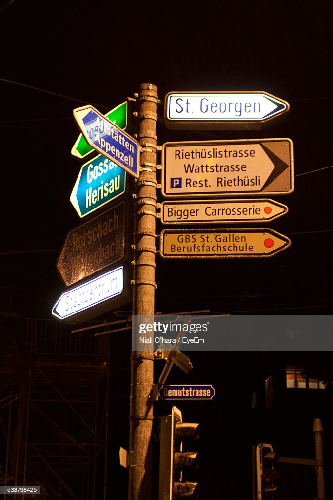 Low Angle View Of Street Signs Against Sky At Night : Foto stock