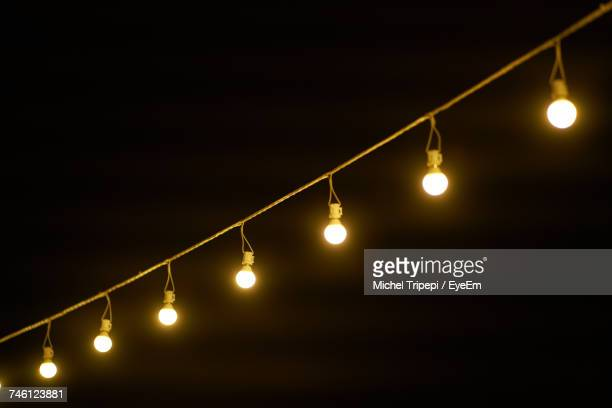 Low Angle View Of String Light Against Clear Sky At Night