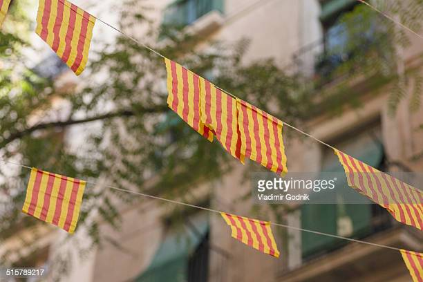 Low angle view of striped flags against building