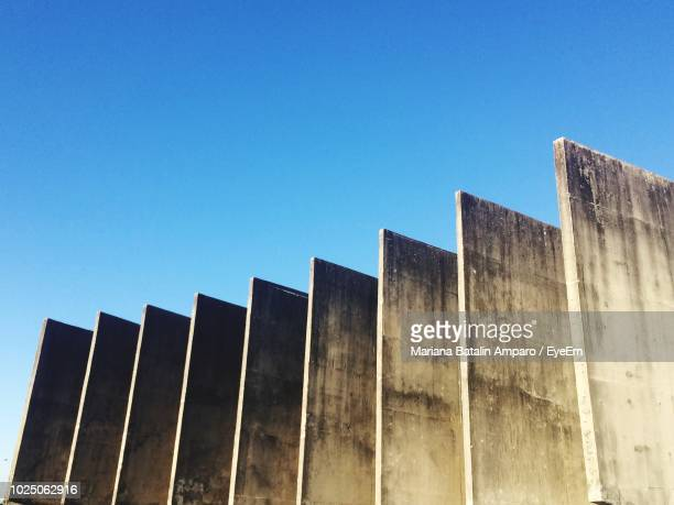 Low Angle View Of Structures Against Clear Blue Sky