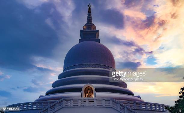 Low Angle View Of Stupa Against Sky At Dusk