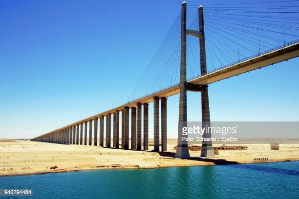 low angle view of suez canal bridge against blue sky - suez canal stock pictures, royalty-free photos & images