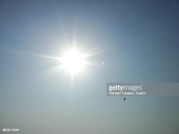 Low Angle View Of Sun Against Clear Sky