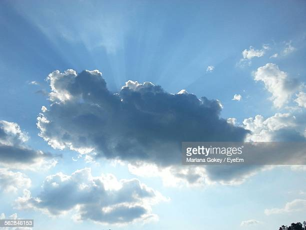 Low Angle View Of Sun Shining Through Clouds