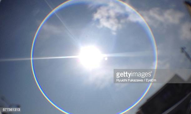 Low Angle View Of Sun Surrounded By Halo