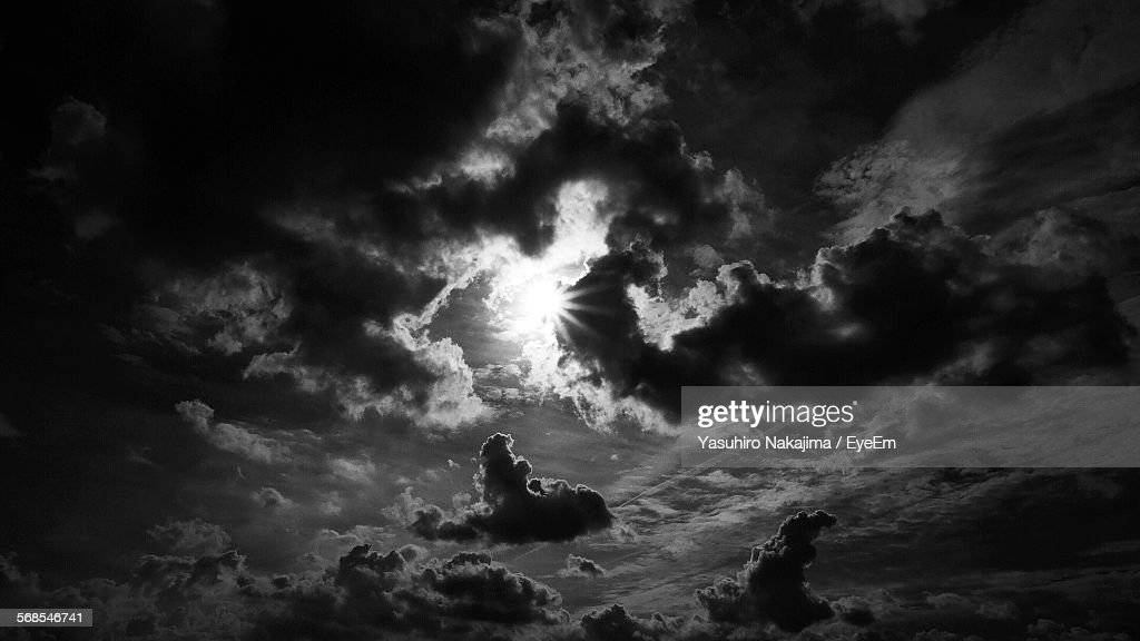 Low Angle View Of Sunlight From Clouds In Sky : Stock Photo