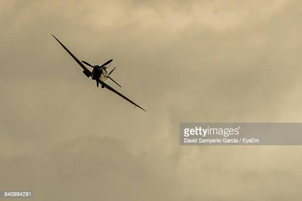 Low Angle View Of Supermarine Spitfire Against Cloudy Sky At Dusk