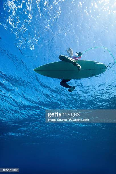 low angle view of surfer in water - low angle view stock pictures, royalty-free photos & images
