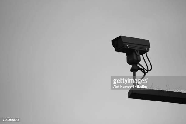 Low Angle View Of Surveillance Camera Against Sky