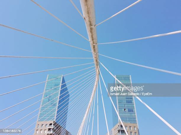 low angle view of suspension bridge against clear blue sky - ビスカヤ県 ストックフォトと画像