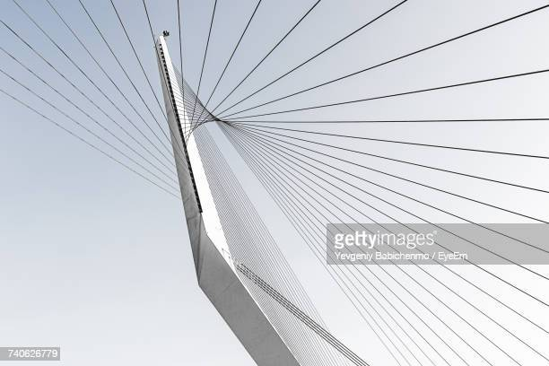 low angle view of suspension bridge against clear sky - suspension bridge stock photos and pictures