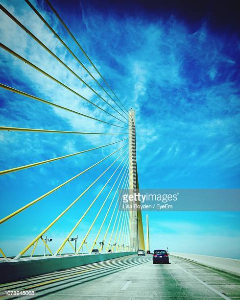 low angle view of suspension bridge against sky - florida usa stock-fotos und bilder