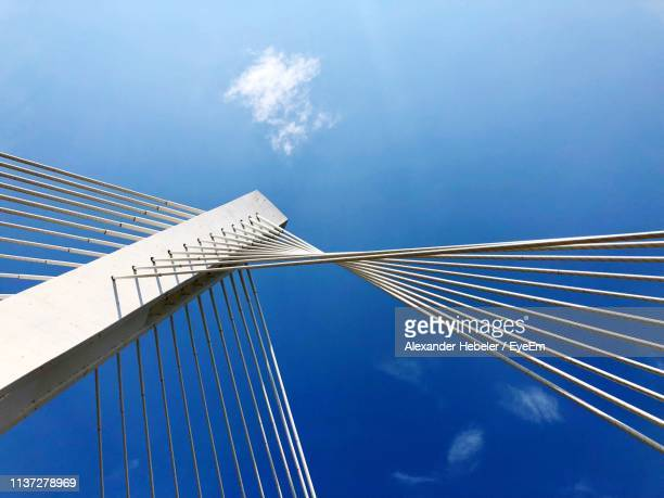 Low Angle View Of Suspension Bridge Against Sky