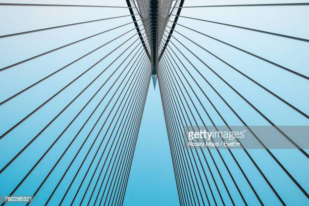 low angle view of suspension bridge against sky - suspension bridge stock photos and pictures