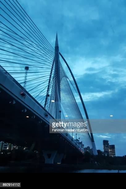 low angle view of suspension bridge against sky - putrajaya stock photos and pictures