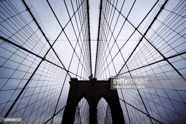 low angle view of suspension bridge - arch stock pictures, royalty-free photos & images