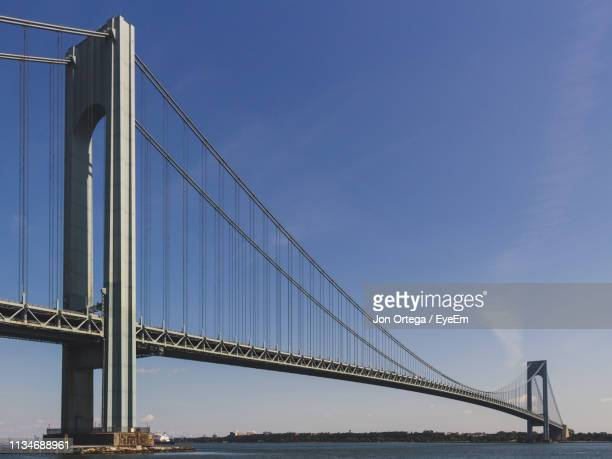 low angle view of suspension bridge - staten island stock pictures, royalty-free photos & images