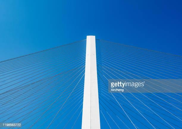 low angle view of suspension bridge - suspension bridge stock pictures, royalty-free photos & images