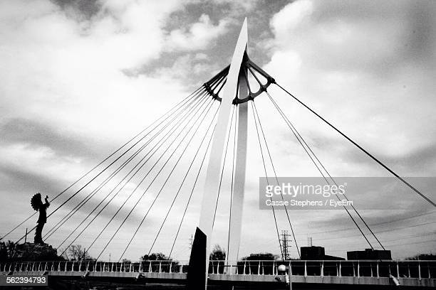 low angle view of suspension bridge - wichita stock photos and pictures