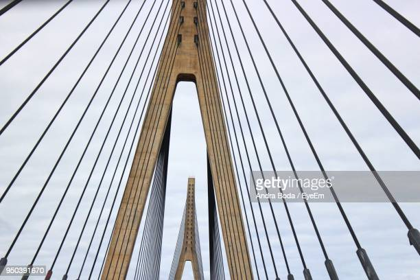 low angle view of suspension bridge - suspension bridge stock pictures, royalty-free photos & images