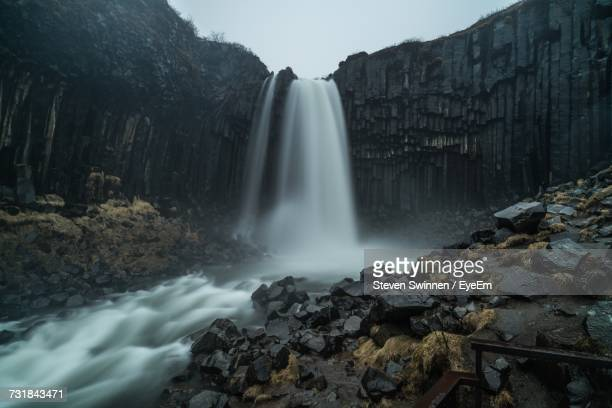 low angle view of svartifoss waterfall - skaftafell national park stock photos and pictures