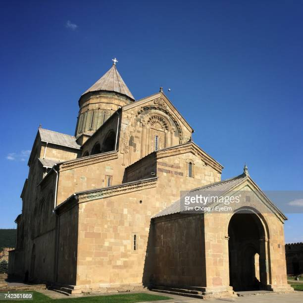 Low Angle View Of Svetitskhoveli Cathedral Against Blue Sky
