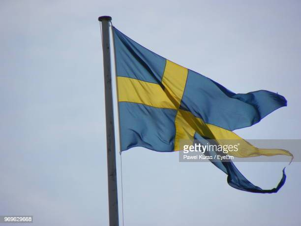 Low Angle View Of Swedish Flag Against Sky