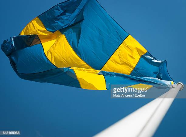 Low Angle View Of Swedish Flag Waving Against Clear Sky