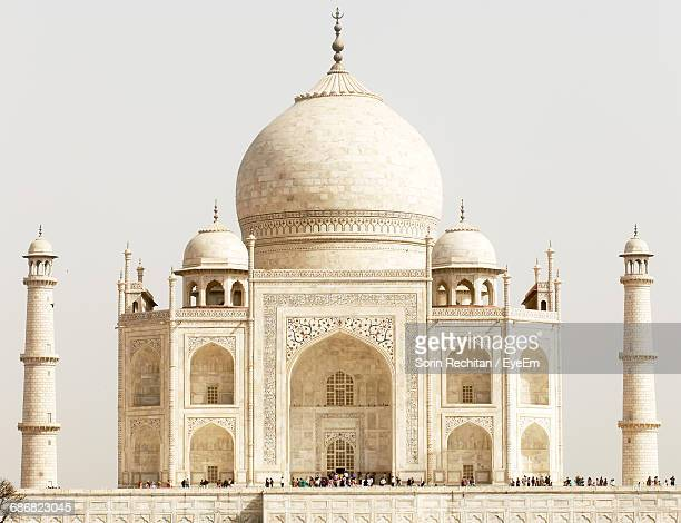 low angle view of taj mahal against clear sky on sunny day - monument stock pictures, royalty-free photos & images