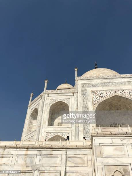 low angle view of taj mahal against clear sky - architectural feature stock pictures, royalty-free photos & images