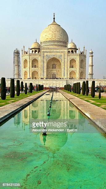 Low Angle View Of Taj Mahal In Front Of Pond Against Sky