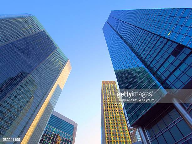 Low Angle View Of Tall Office Buildings Against Blue Sky At Siodome