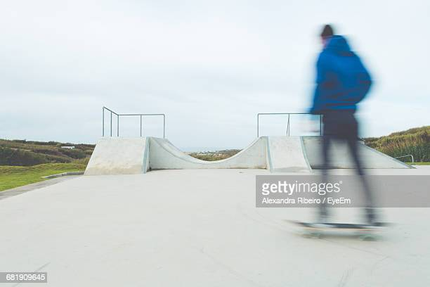 Low Angle View Of Teenager At Skateboard Park