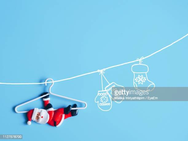 low angle view of telephone pole against blue sky - cartoon santa claus stock photos and pictures