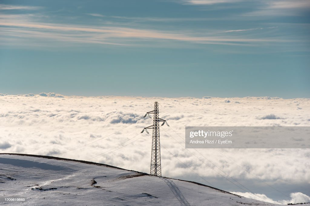 Low Angle View Of Telephone Pole Against Sky During Winter : Foto stock