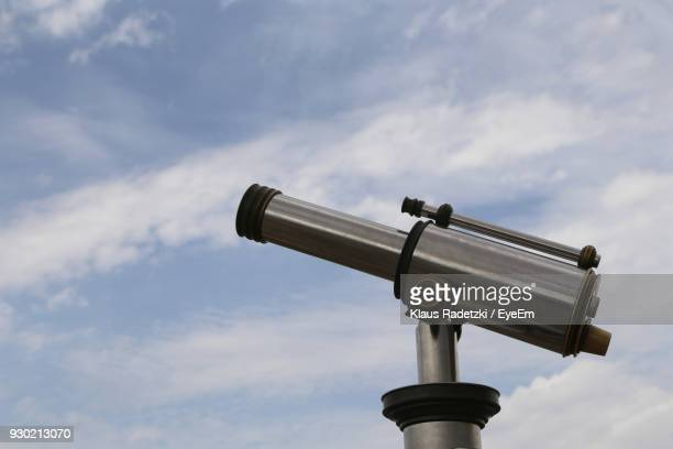 Low Angle View Of Telescope Against Cloudy Sky