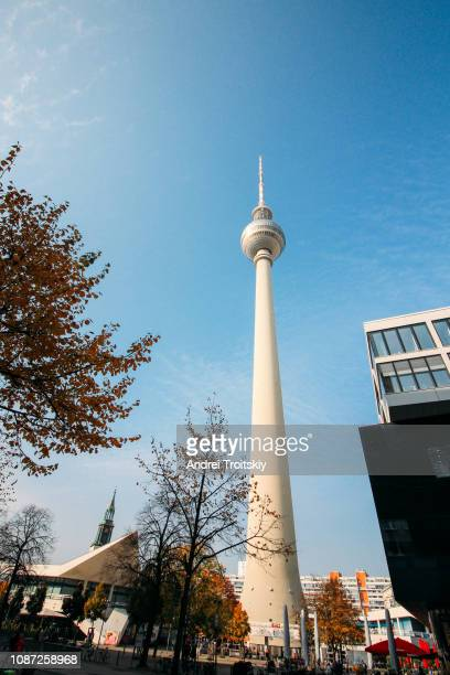 low angle view of television tower (fernsehturm) in berlin, germany - television tower berlin stock pictures, royalty-free photos & images