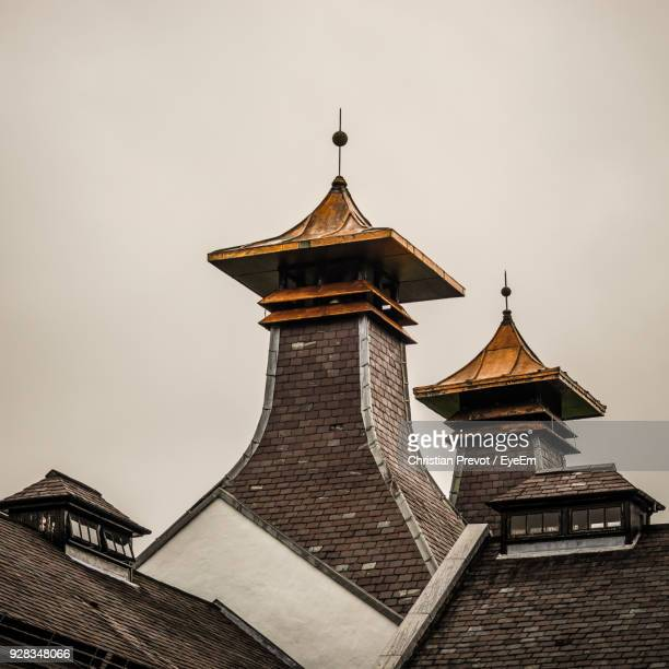 low angle view of temple against sky - distillery stock pictures, royalty-free photos & images