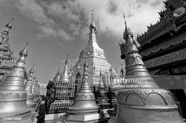 low angle view of temple building against sky - gerhard schimpf stock pictures, royalty-free photos & images