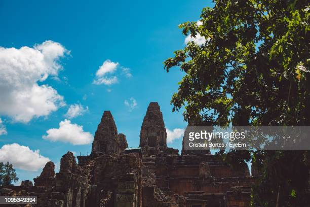 low angle view of temple by tree against sky - bortes stock pictures, royalty-free photos & images