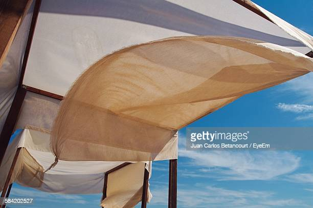 Low Angle View Of Tent At Beach Against Sky