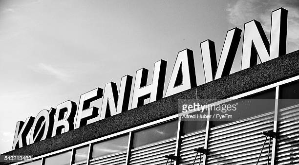 low angle view of text on building against sky - oresund region stock photos and pictures