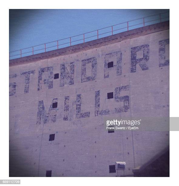 low angle view of text on wall - frank swertz stockfoto's en -beelden