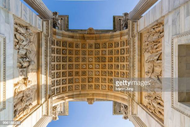 Low angle view of the Arco della Pace, Peace Arch, 1807-1838, design and construction started by Luigi Cagnola, completed by Francesco Londonio and Francesco Peverelli, classicism, Piazza Sempione, Milan, Lombardy, Italy
