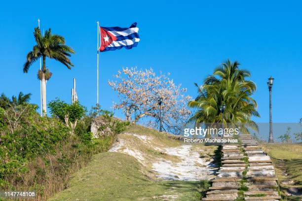 Low angle view of the Capiro Hill There is a large Cuban flag waving in the wind The place is a Cuban National Monument and a tourist attraction in...