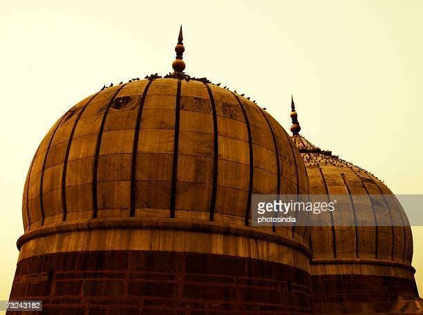 low angle view of the domes on a mosque, jama masjid, new delhi, india - jama masjid delhi stock pictures, royalty-free photos & images