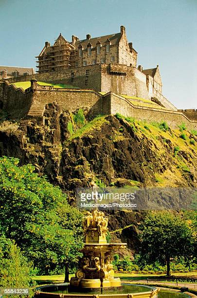Low angle view of the Edinburgh Castle at a rocky cliff, Edinburgh, Scotland
