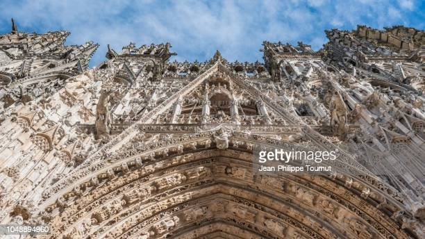 low angle view of the extremely detailed facade of the gothic cathedral of rouen, cathédrale notre-dame de l'assomption de rouen, normandy, france - rouen stock pictures, royalty-free photos & images